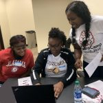 Kids studying coding at camp